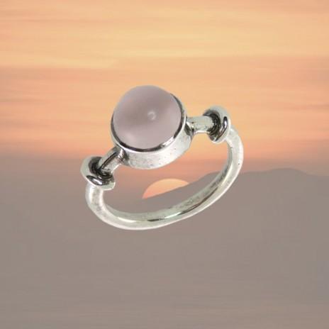 Bague argent design quartz rose serti clos