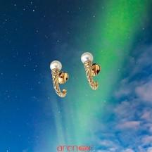 Boucles d'oreilles torsadées en or jaune avec perle de culture